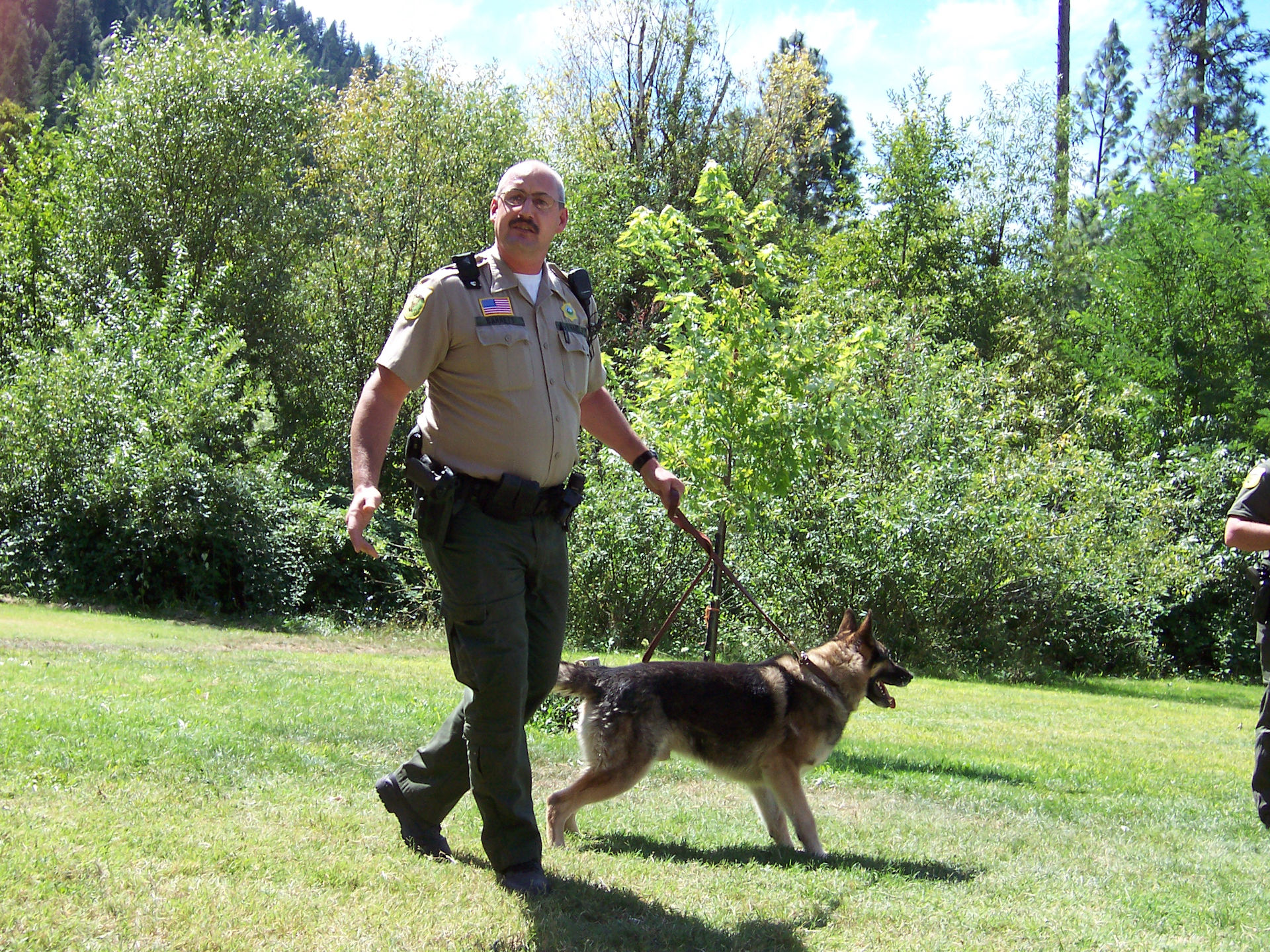 A deputy with his K9 dog at the Happy Camp, CA Bigfoot Jamboree in 2005.